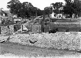 Picture relating to Acton - titled 'Australian Institute of Anatomy foundations being constructed, McCoy Circle, Acton.'