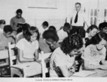 Picture relating to Cherbourg - titled 'Students in school at Cherbourg, 1952'