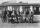 Picture relating to Canberra - titled 'Presentation of Charter of Rotary Club, group photo [Sir Robert Garran, Sir John Butters and CS Daley can be identified] in front of Hotel Canberra.'