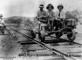 Picture relating to Blackall - titled 'Three men sitting on a quadricycle on the railway lines at Blackall, Queensland, ca.1919'
