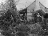 Picture relating to Toowoomba - titled 'Two women and a boy in a garden on the Range at Toowoomba, Queensland'