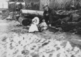 Picture relating to Sandgate - titled 'Two young children playing on Sandgate beach, Brisbane, ca. 1927'