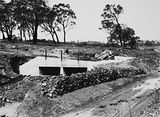 Picture relating to Fairbairn Avenue - titled 'Drainage culvert, under construction on Duntroon Road now Fairbairn Avenue, Campbell.'