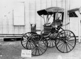Picture relating to Charters Towers - titled 'Carriage with leather upholstery outside Towers Carriage Works, Charters Towers, ca. 1910'
