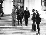 Picture relating to Parliament House - titled 'Sir John Butters with Naval and Army officers on steps of Old Parliament House'