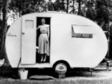 Picture relating to Queensland - titled 'Mrs Dudley Courtman in her Chesney caravan, 1952'