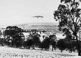 Picture relating to Ainslie - titled 'Snow fall - View from Red Hill over Capital Hill to Reid. Mt. Ainslie in background.'