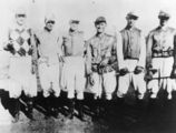 Picture relating to Nebo - titled 'Group of jockeys pictured before a race at Nebo, ca. 1938'