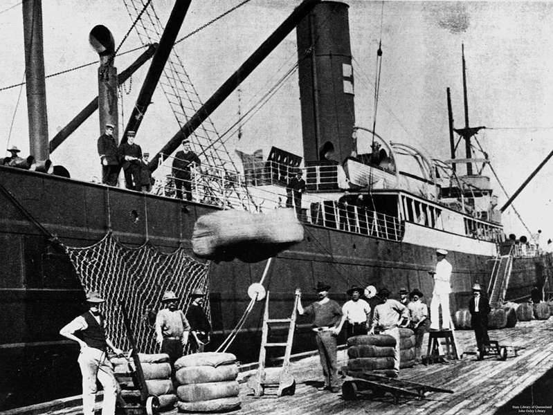 Picture of / about 'Brisbane' Queensland - Bales being loaded onto a ship docked at Musgrave Wharf, Brisbane, Queensland, 1908