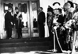 Picture relating to Parliament House - titled 'Duke of York opening the front door of Old Parliament House, Prime Minister Rt Hon Stanley Bruce on the left, Governor General on right.'