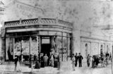 Picture of / about 'Brisbane' Queensland - People gathered in front of Finney, Isles & Co, corner Queen and Edward Streets, Brisbane, ca. 1873