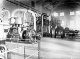 Picture relating to Kingston - titled 'Kingston Power Station. Robey Hall 150 kW twin cylinder steam engine and alternator with two Bellis and Morcomb 600 kW 3 cylinder triple expansion steam engines with alternators.'