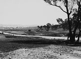 Picture of / about 'Reid' the Australian Capital Territory - Duntroon Road now Fairbairn Avenue, Campbell, looking towards Reid. Site of the War Memorial on the right.
