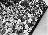 Picture relating to Canberra - titled 'Mr & Mrs Scullin with the welcoming crowd at Canberra Railway Station'