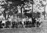 Picture relating to Tiaro - titled 'Members of the Tiaro School Calf Club, Queensland, with their calves, ca. 1930'