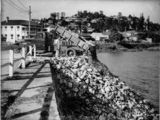 Picture relating to Hamilton - titled 'Building a retaining wall on Kingsford Smith Drive, Hamilton, Brisbane, ca. 1935'