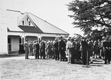 Picture relating to Yarralumla - titled '15th Australian Provincial Press Conference - Delegates in line to be introduced to the Governor General, Lord Stonehaven and his Lady at Government House, Yarralumla, the residence of the Govenor- General.'