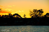 Picture relating to Lake Macquarie - titled 'Green Sillouette amongst the Gold-Lake Macquarie'