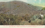Picture relating to Cooktown - titled 'Granite rocks piled high to form Black Mountain near Cooktown, ca. 1906'