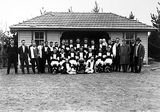 Picture relating to Ainslie - titled 'Ainslie Australian Rules Football team with officials'
