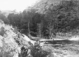 Picture relating to Cotter Dam - titled 'Downstream from the Cotter Dam wall and stilling pond to the Cotter River'