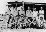 Picture relating to Hughenden - titled 'Soldiers posing with their mascot dog at camp, Hughenden, ca. 1940'