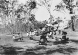 Picture relating to Queensland - titled 'Group of children on a large seesaw, possibly at Nanango'