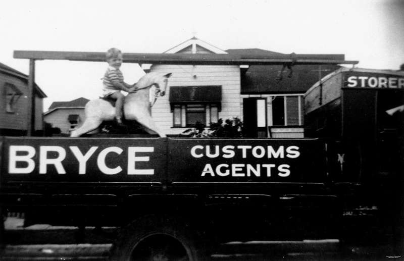 Picture of / about 'Brisbane' Queensland - Child riding a rocking horse on the back of a delivery truck, Brisbane