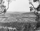 Picture relating to Black Mountain - titled 'Reid, Braddon and Civic Centre. Ainslie Hotel in centre. Black Mountain on right.'