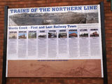 Picture relating to Werris Creek - titled 'Train info poster in the main street (Single St = Werris Creek Rd).'