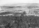 Picture relating to Reid - titled 'View from Mt Ainslie over Ainslie Avenue including Reid, Braddon and Civic Centre etc, Ainslie Hotel and Gorman House, Reid to the right.'