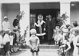 Picture relating to Barton - titled 'Children with Santa Claus and Headmaster at Telopea Park School, New South Wales Crescent, Barton.'