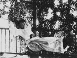 Picture relating to Fraser Island - titled 'Woman in a hammock on the verandah, Fraser Island, Queensland, ca. 1895'