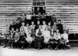 Picture relating to Queensland - titled 'Group portrait of teacher and students, possibly at Nanango, 1900-1910'