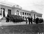 Picture relating to Parliament House - titled 'Group of Empire Parliamentary Association delegates in front of Old Parliament House. Canberra Boy Scouts providing the Guard of Honour.'