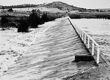 Picture relating to Duntroon - titled 'Footbridge over the weir on the Molonglo River behind the Kingston Power Station which led to Duntroon'
