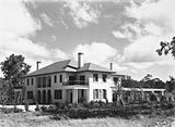Picture relating to Deakin - titled 'Prime Minister's Lodge, Adelaide Avenue, Deakin. Gardens now well developed.'