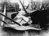 Picture relating to Rockhampton - titled 'BE-2B aeroplane after hitting a stump at Rockhampton, 1920-1930'