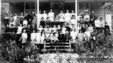 Picture relating to Canungra - titled 'Children and teachers of the Canungra State School, ca. 1910'