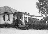 Picture of / about 'Canberra' the Australian Capital Territory - Canberra Community Hospital building with baby Austin 7 Tourer Car