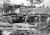Picture relating to Brisbane - titled 'Remains of the Enoggera Creek Bridge after a flood in Brisbane, 1935'