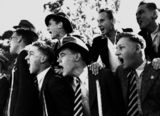 Picture relating to Queensland - titled 'Cheering schoolboys, possibly at a sporting event, 1940-1950'