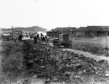 Picture relating to Kingston - titled 'Cletrac crawler tractor pulling plough for road making near Kingston shops'