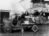 Picture relating to Longreach - titled 'Passengers on the Jundah Mail Transport by Cobb & Co., Longreach, Queensland, ca. 1920'