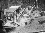 Picture relating to Mugga Quarry - titled 'Stone crushing plant at Mugga Quarry. Conveyor belt taking away crushed rock.'