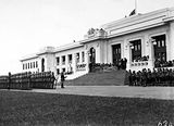 Picture of / about 'Parliament House' the Australian Capital Territory - Armistice Day Ceremony with the Royal Military College Cadets on parade in front of Old Parliament House Boy Scouts on the right, View from Parkes Place.