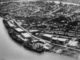 Picture relating to Brisbane - titled 'Ships docked at the Teneriffe Wharves, Brisbane, Queensland, ca. 1925'