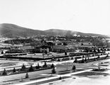 Picture relating to Canberra - titled 'Commonwealth Avenue and Hotel Canberra from West Block'