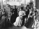 Picture relating to Queensland - titled 'Members of the Woodyatt and Alder families on the verandah, ca. 1905'