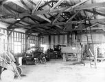 Picture relating to Kingston - titled 'Interior of a garage showing cars, truck and a motor cycle at Kingston Depot.'